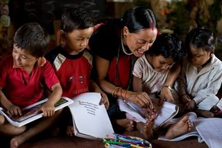 Save the Children's Literacy Boost program promotes training teachers and creating a culture of reading outside of the classroom. Photo Credit: Brent Stirton for Save the Children