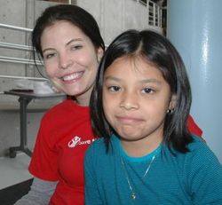 Kelly and Save the Children's Amy Richmond at a hurricane shelter in New Jersey.