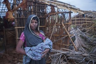 SavetheChildren_Cyclone_Phailin_house_mother_baby_2013
