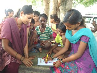 Babita drawing for sponsor with sponsorship staff