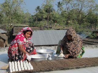 Preparing Kumro Bori on the roof of  a house