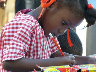 Celinecia Chama-7 years old-making a drawing for her sponsor
