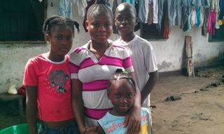 RS85579_4 of 5 kids who lost their parents to Ebola in Monrovia