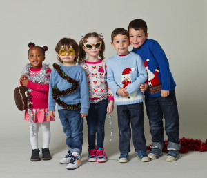 Kids can help make the world better by wearing a holiday sweater on Dec. 12. Photo by Dan Burn-Fort / Save the Children.