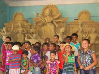 The children at the third stage of Durga idol making