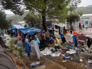 RS108617_People in Moria camp after three days of storms hit the island of Lesvos.