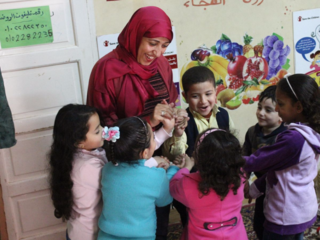 Maha playing a game with preschool children