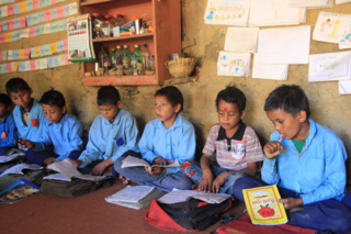 Santosh and his friends in their colorful classroom