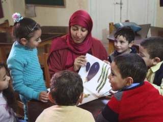 During a visit to an ECCD class, Maha assesses the children's understanding of some words