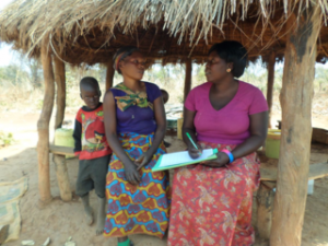 Evelyn conducting child enrollments into Sponsorship