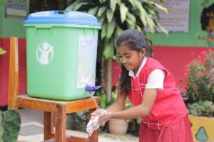 Melania practicing her handwashing