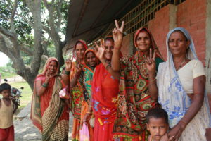 Guheshwori, second from the left, and the other female attendees playfully show the peace sign.