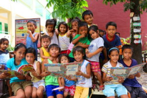Children in a reading camp in the Philippines. Photo Credit: Save the Children: Philippines