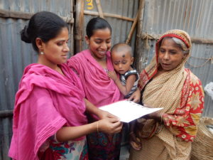 Sufia shares the letter with neighbors while little Sabbir is curious to join in the excitement