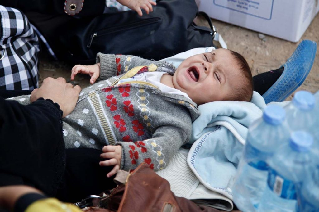 6-month-old baby girl *Sara cries at Dibis checkpoint near the Iraqi city of Kirkuk.