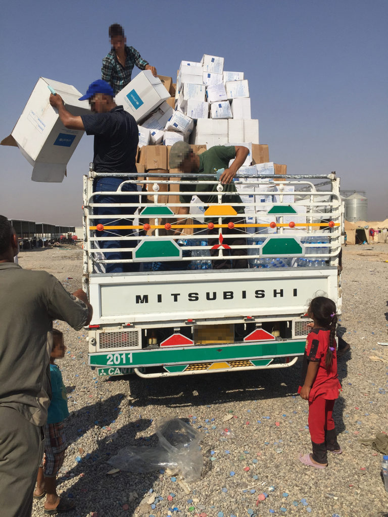 Distribution in Salah ad Din province – trucks being readied to meet new arrivals at screening.