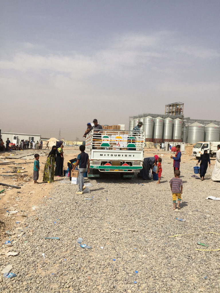Rapid response distribution for new arrivals at a screening center in Salah ad Din province, Iraq. These trucks are loaded with boxes pre-positioned for newly expected arrivals from areas of conflict in the north as a result of the impending Mosul offensive. At least 150,000 people have been displaced so far and the offensive could force over 1 million people to flee their homes.