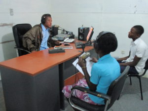Adolescents sharing their messages on health over the community public radio.