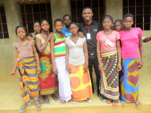 Osvaldo poses with adolescents who benefit from our programs.