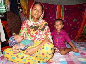 ferdousi-with-her-children-at-their-home-in-the-slums-of-rayerbazar