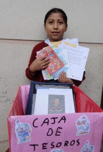 Jazmin with her 'treasure box' full of letters, photos and small gifts.