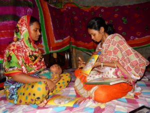 rubina-a-sponsorship-community-volunteer-visiting-ferdousi-at-her-home-in-rayerbazar-slum
