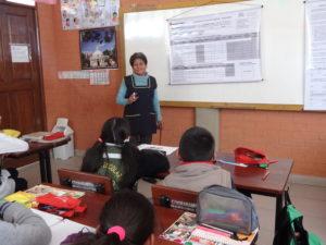 Justa explaining the Sponsorship enrollment process to children.