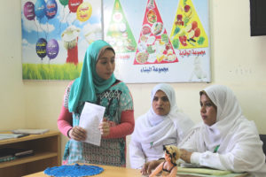 Samar conducting a training with local nurses.