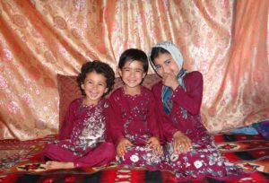 A happy Malina (middle) and her sister Madina and Malya.