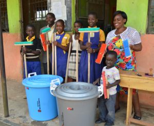 Teachers George and Jennifer, Robinah (third from left), Linda, Gift & Kefa with the schools new cleaning materials.
