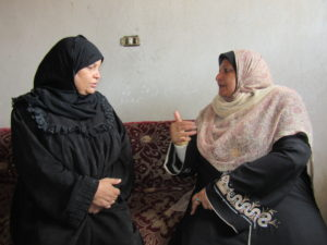 Amal meeting with a local woman about her livelihoods project.