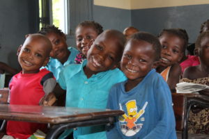 A smiling Issufo (center) with his classmates at the early learning center.