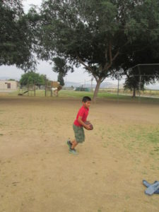 Steven loves being outside and is learning to play football and soccer.