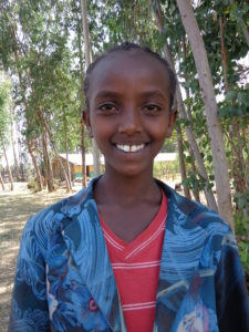 12-year-old Gelane is happy and proud to finally be back in school.