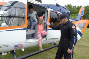 Local first responders from Mercy Hospital showed students how the helicopter and its crew can help someone who is hurt or sick. Photo by Bob Coleman.