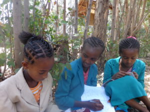 Gelane studying with some classmates from her sponsorship supported school.