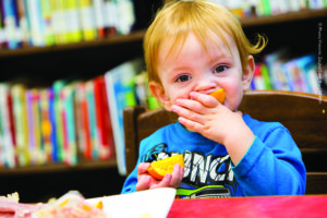 2-year-old AJ snacks on an orange slice to promote Healthy Choices on Tuesday, March 7, 2017 in Clay Country, Kentucky.