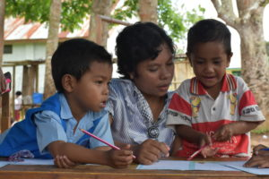 Author Yasintha working with kids who benefit from sponsorship programs like Reading Camps.