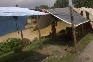 Children in Saptari taking refuge in temporary shelters while their homes are submerged in flood waters.