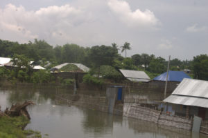 Floods consuming a small village.