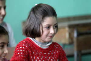 Basma*, 8, is from southern Syria but fled from her home when her school was attacked in an airstrike that injured many of her friends. Photo:  Khalil Ashawi/Save the Children