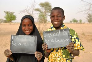 Adam and his classmate Raouda show their dreams for the future.