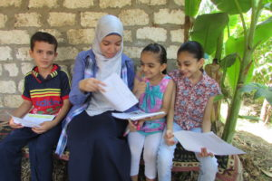 Gehad delivering letters to Osama, Nourhan and Shahd.</em