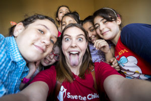 Global Sponsorship Multimedia Storyteller Victoria Zegler takes a selfie with children participating in Save the Children's refugee sponsorship program in Egypt.