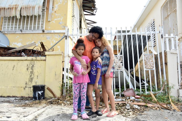 Martina watches over three of her grandchildren as their mother works, October 2017. Like most families, they're coping with the realities of life and loss after Hurricane Maria struck the island in September 2017.