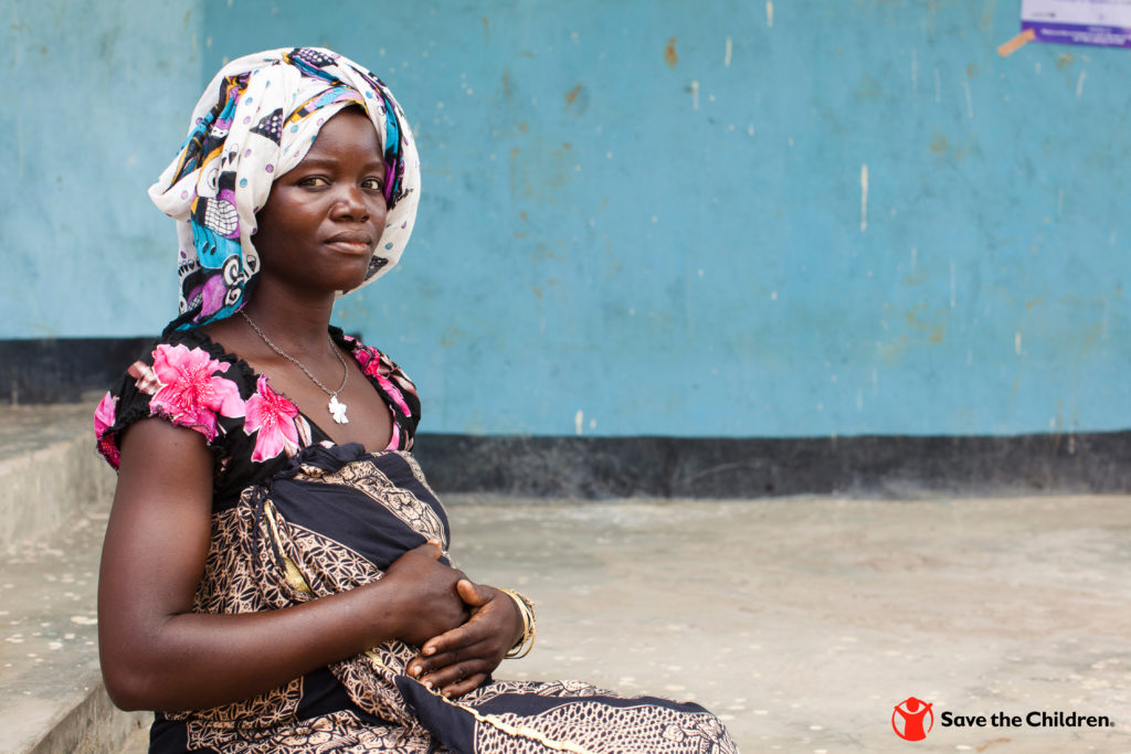 At a Save the Children-supported health center in Tanzania, Zinak*, 24 and 7-months pregnant, receives a prenatal check up.