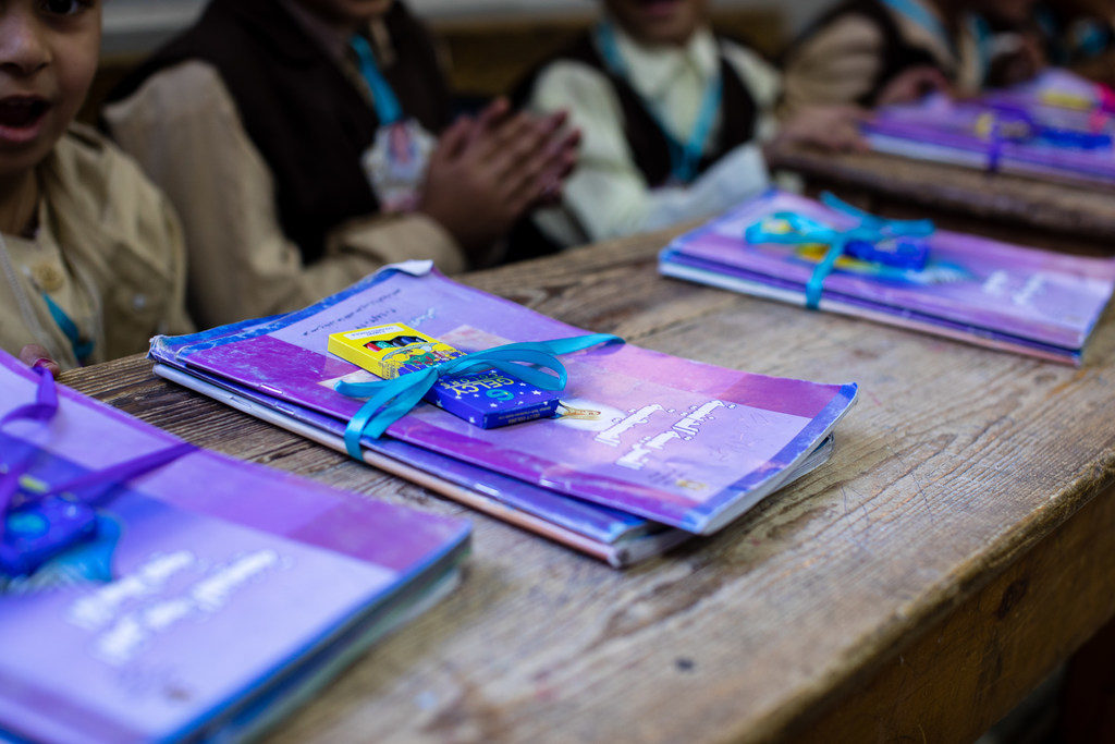 School books and crayons are given to children at the start of the school year, Oct. 3, 2017 in Assuit, Egypt