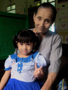 4-year-old Lay Pyay and her grandmother, Daw Aye One.