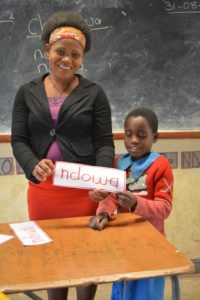 Modester in her classroom in Zomba, with one of her students.