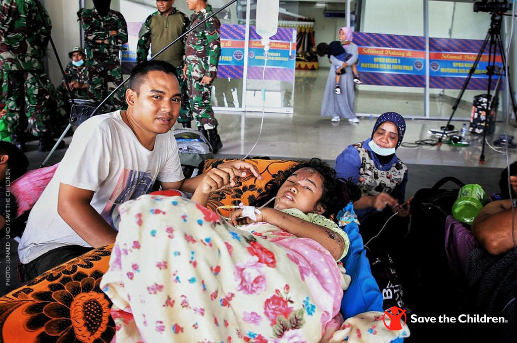 Puri  With Her Brother Dimas  Await An Emergency Plane In Palu Indonesia To Take Them To Makassar For Treatment Photo Credit Junaedi Uko Save